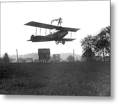 Stunts Atop A Biplane Metal Print by Underwood Archives