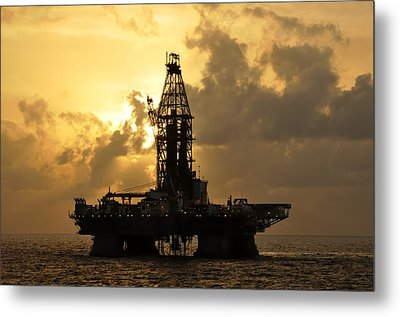 Metal Print featuring the photograph Sun Behind Oil Rig With Clouds by Bradford Martin
