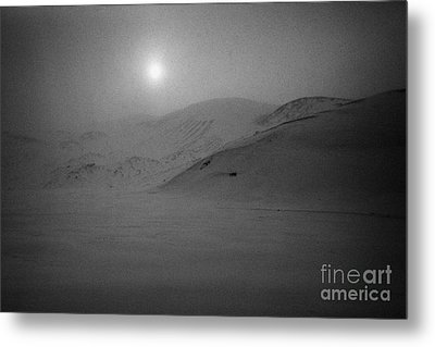 sun breaking through white out snowstorm whalers bay deception island Antarctica Metal Print by Joe Fox