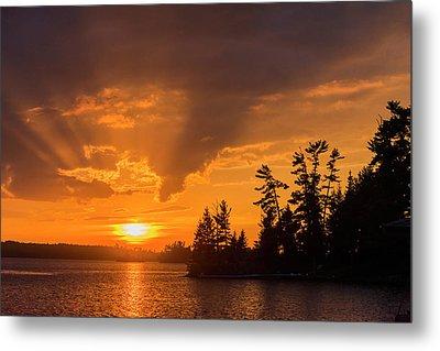 Sunrise Casting An Orange Glow Metal Print