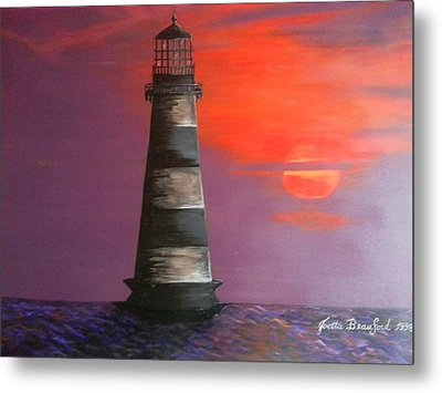 Sunset And Lighthouse Metal Print by Joetta Beauford