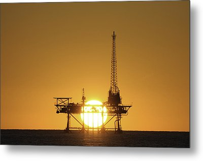 Metal Print featuring the photograph Sunset Behind Oil Rig by Bradford Martin
