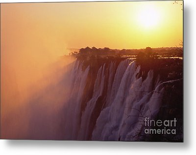 Sunset Over The Victoria Falls Metal Print by Alex Cassels