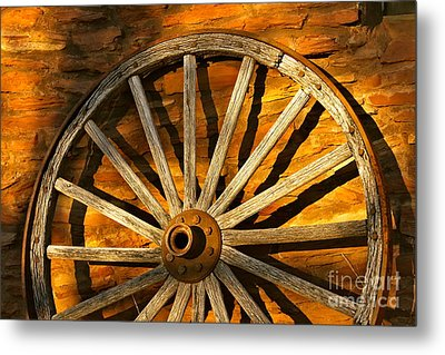 Sunset Wagon Wheel Metal Print by Michael Cinnamond