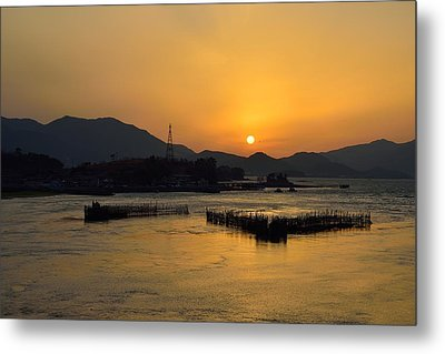 Sunset With Facility For Fishing Anchovy By Flow Of Sea Water Metal Print