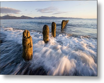 Surf Rushing Around Old Pilings Along Metal Print