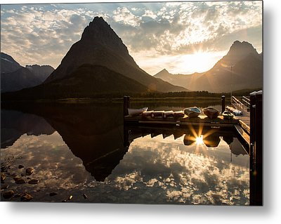 Swiftcurrent Lake Boats Reflection And Flare Metal Print by John Daly
