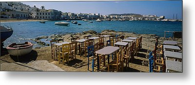 Tables And Chairs In A Cafe, Greece Metal Print by Panoramic Images