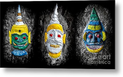 Temple Faces Metal Print by Adrian Evans