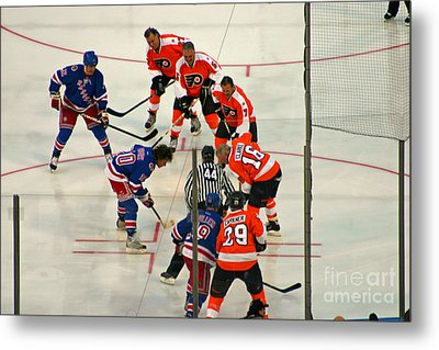 The Faceoff Metal Print by David Rucker