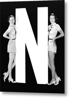 The Letter n  And Two Women Metal Print by Underwood Archives