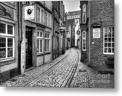 The Narrow Cobblestone Street Metal Print