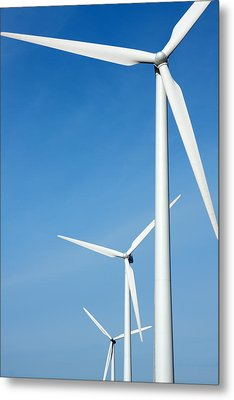 Three Mighty Windmills In A Row Against A Blue Sky. Metal Print