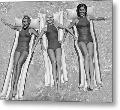 Three Women Floating In A Pool Metal Print by Underwood Archives