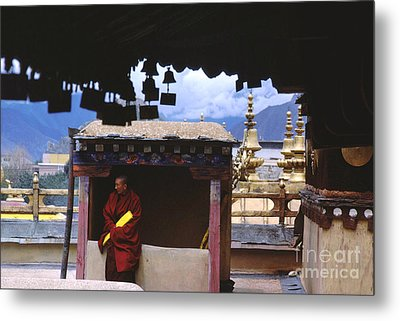 Tibetan Monk With Scroll On Jokhang Roof Metal Print by Anna Lisa Yoder