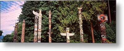Totem Poles In A Park, Stanley Park Metal Print by Panoramic Images