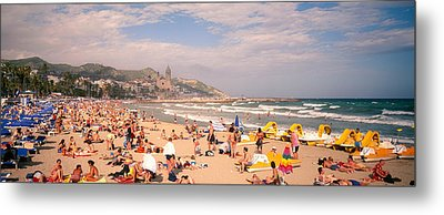 Tourists On The Beach, Sitges, Spain Metal Print by Panoramic Images
