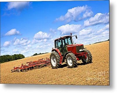 Tractor In Plowed Farm Field Metal Print by Elena Elisseeva