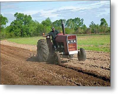 Tractor Ploughing A Field Metal Print