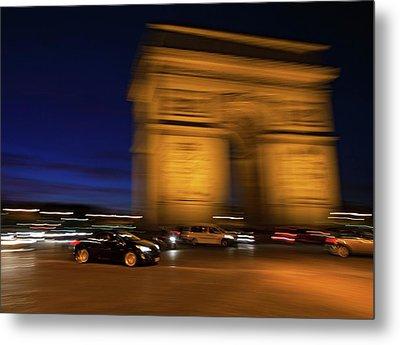 Traffic At The Arc De Triomphe Metal Print by Babak Tafreshi