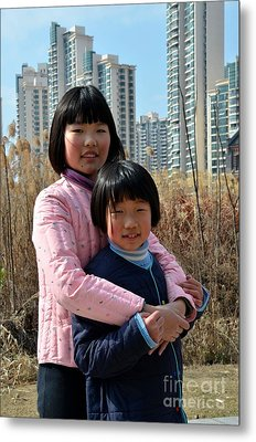 Two Chinese Teen Sisters Hug  And Embrace Shanghai China Metal Print by Imran Ahmed