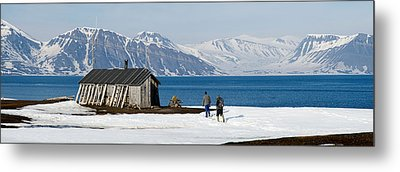 Two Hikers Standing On The Beach Metal Print by Panoramic Images