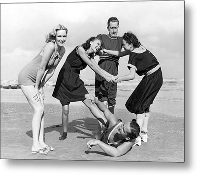 Two Women Tussle On The Beach Metal Print by Underwood Archives