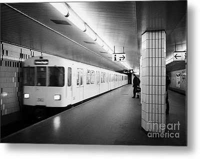 u-bahn train pulling in to ubahn station Berlin Germany Metal Print