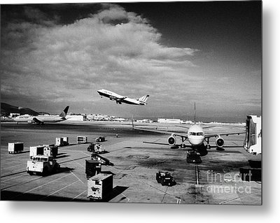 united airlines aircraft taking off taxiing and on stand at the San Francisco International Airport  Metal Print by Joe Fox