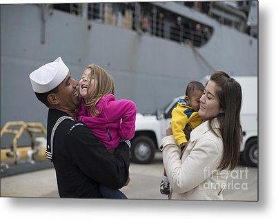 U.s. Navy Sailor Greets His Family Metal Print by Stocktrek Images