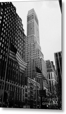 view of pennsylvania bldg nelson tower and US flags flying on 34th street from 1 penn plaza new york Metal Print by Joe Fox