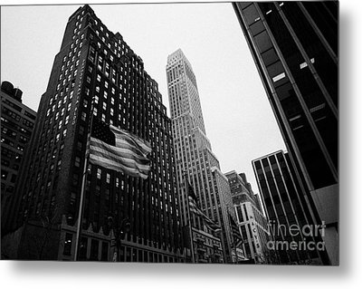 view of pennsylvania bldg nelson tower and US flags flying on 34th street from 1 penn plaza nyc Metal Print by Joe Fox