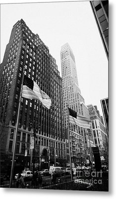view of pennsylvania bldg nelson tower and US flags flying on 34th street new york city Metal Print