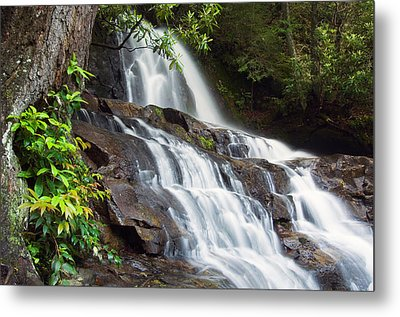 Water Cascading Over Rocky Cliffs Metal Print