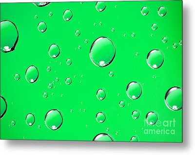 Water Drops On Green Metal Print by Sharon Dominick