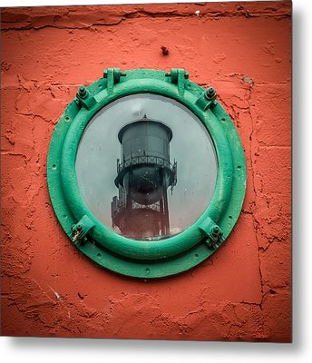Water Tower Reflection Metal Print by Paul Freidlund