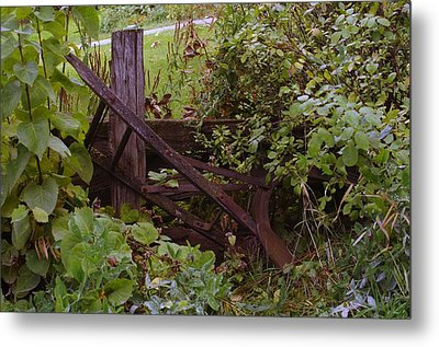 Where An Old Plow Rests  Metal Print by Jeff Swan