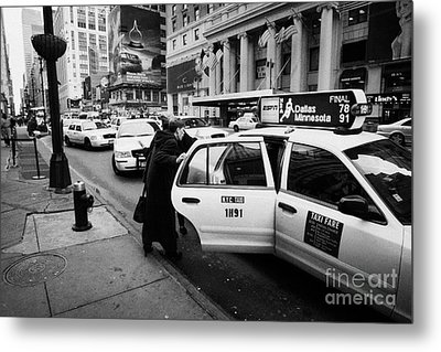 white middle aged passengers exit from yellow cab rear door at taxi rank on 7th Avenue Metal Print by Joe Fox