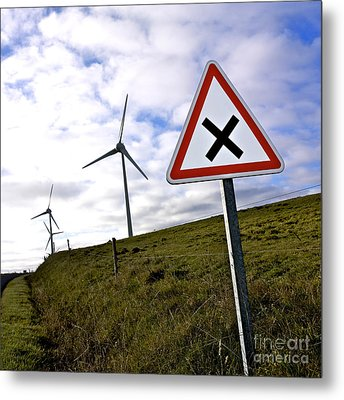 Wind Turbines On The Edge Of A Field With A Road Sign In Foreground. Metal Print by Bernard Jaubert