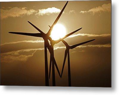 Wind Turbines Silhouette Against A Sunset Metal Print