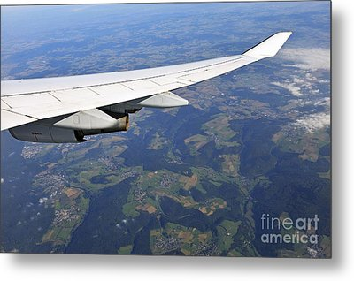 Wing Of Flying Airplane Over German Villages Metal Print