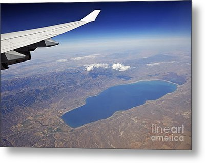 Wing Of Flying Airplane Over Lake And Mountains Metal Print