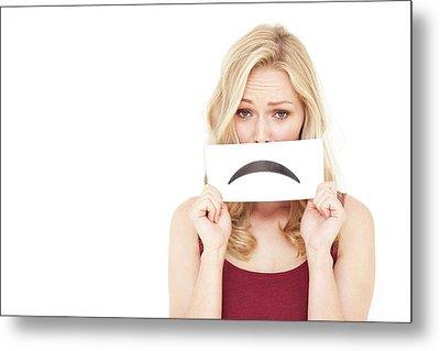 Woman Holding Sad Mouth Metal Print by Ian Hooton