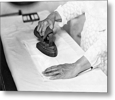 Woman Ironing With Flat Iron Metal Print by Underwood Archives