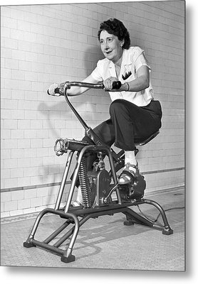 Woman On Exercycle Metal Print by Underwood Archives
