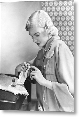Woman Taking Care Of Her Nails Metal Print by Underwood Archives