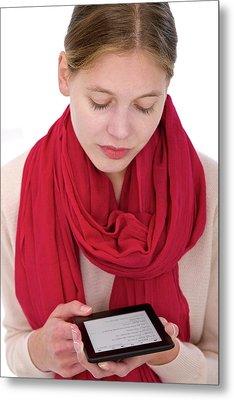 Woman Using E-reader Metal Print