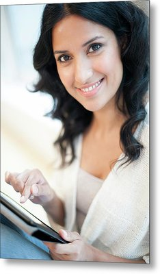 Woman Using Tablet Metal Print