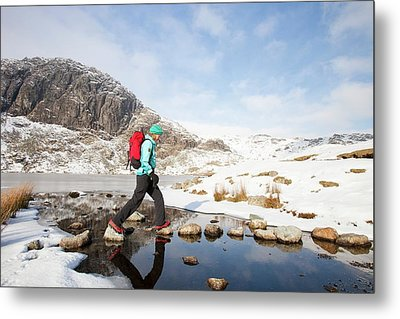 Woman Walker And Frozen Stickle Tarn Metal Print by Ashley Cooper