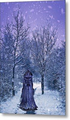 Woman Walking In Snow Metal Print by Amanda Elwell